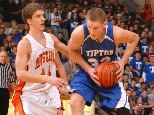 Tipton's Derek Elston (right)