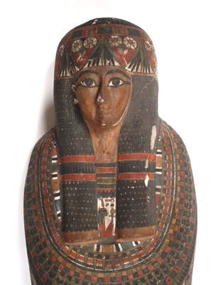 """The cartonnage, or case that surrounded the mummy of Nakhte-Bastet-Iru, an Egyptian priest's daughter who died around 2,800 years ago, is part of the new """"Egypt: Be Curious"""" exhibit opening Saturday at the Grand Rapids Pubic Museum."""