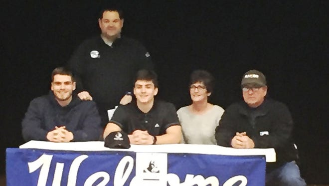 Cameron Racke and family celebrate his signing to Wofford.