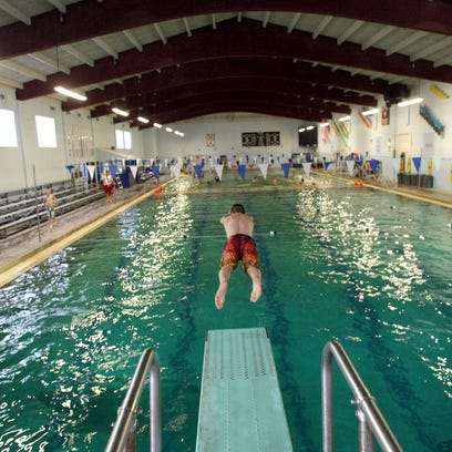 Connor Anchick,15, dives into the pool from the low