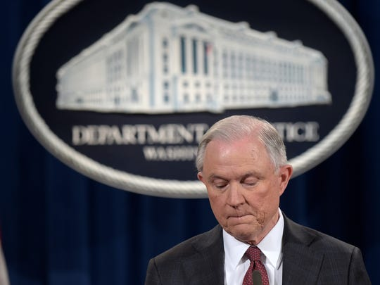 Attorney General Jeff Sessions pauses during a news