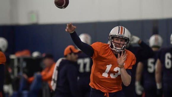 Auburn quarterback Sean White throws a pass in practice