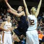 Concordia-St. Paul's Jodi Batzel shoots past Northern State's Alison Kusler (32) and Sadie Stotesbery during the NSIC women's championship at the Sanford Pentagon on Tuesday night. The Golden Bears won 54-36.