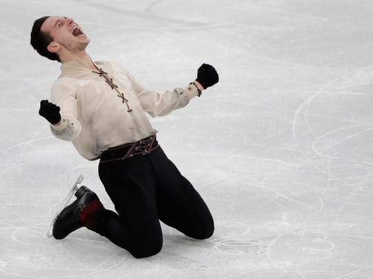 Alexei Bychenko of Israel reacts after his performance in the men's free figure skating final in the Gangneung Ice Arena at the 2018 Winter Olympics in Gangneung, South Korea.