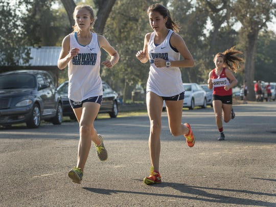 Redwood's Kate Phippen, left, and Kylee Dismuke run side by side in the girls varsity race in the West Yosemite League cross country championship on Wednesday, November 9, 2016 in Visalia. Dismuke placed third and Phippen placed fourth. The event included runners from El Diamante, Golden West, Hanford, Hanford West, Lemoore, Mt. Whitney and Redwood.