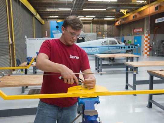 Student Jesse Marti learns aviation maintenance technology