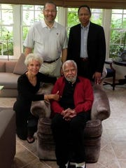 Mitchell Spellman (seated) is shown in this May 2013 photo with (clockwise from left) his third wife, Olivia, son, Frank, and Dr. Arnold Eugene Washington, the dean of the UCLA School of Medicine. Olivia was at Mitchell's side six months later at the time of his death at home. He was predeceased by his first two wives, Billie and Adrian.