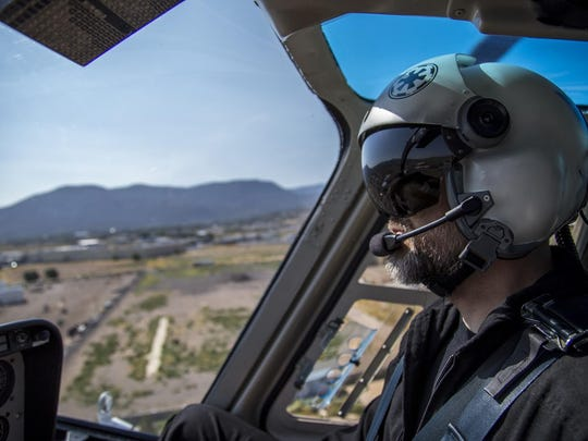 Chief flight instructor Mike Mower flies west of Cedar