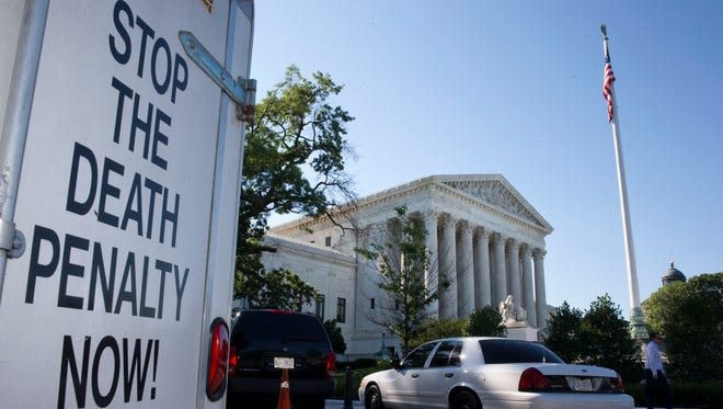 A sign outside the Supreme Court in June 2015 urges an end to capital punishment. The justices heard yet another death penalty case Tuesday.
