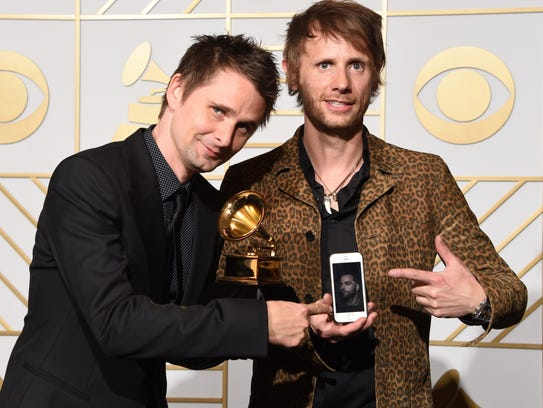 Muse pose in the press room with their Best Rock Album