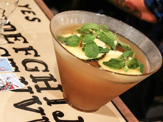 "Joshua Gonzales, bartender at the Thunderbird, serves up his punch called ""Abraxas Ascending""  to the judges."