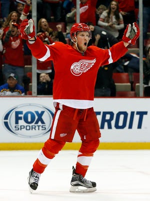Detroit Red Wings' Justin Abdelkader celebrates after scoring against the St. Louis Blues in overtime of an NHL hockey game in Detroit, Sunday, March 22, 2015.