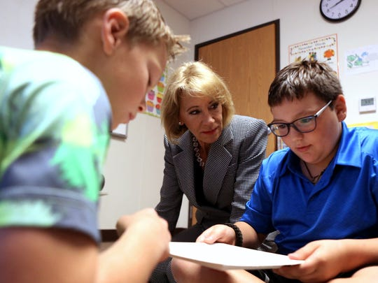 U.S. Secretary of Education Betsy DeVos (center) watches as  Olsen Elementary School third-graders Torres Conrad, 8 (left), and Stratton Mills, 8, play a counting game during class while she visits Port Aransas on Wednesday, Nov. 15, 2017. DeVos visited to see firsthand the ongoing rebuilding and recovery in the wake of Hurricane Harvey and to assess how her department could continue to coordinate and support the state, schools and students.