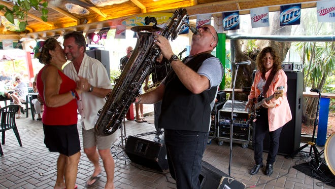 """Baritone sax player Don Hulgas plays """"Alright, Okay, You Win"""" with Deb & the Dynamics at Pinchers Crab Shack Tiki Bar on Fort Myers Beach."""