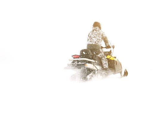 Man on snowmobile. Winter sports.