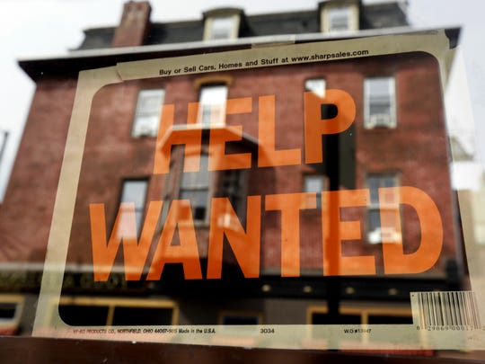 "A ""Help Wanted"" sign hangs outside a business on St. George Boulevard. Utah ranked as having among the fastest-growing job markets and overall economies in a new analysis by 24/7 Wall Street."