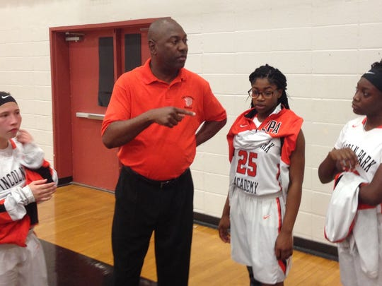 Lincoln Park Academy girls basketball coach Wendell Adams (center) talks with players after the Greyhounds' District 15-6A semifinal win against Port St. Lucie Wednesday, Feb. 7, 2018 at Port St. Lucie High School.