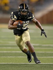 Southern Miss running back Ito Smith (25) runs in the