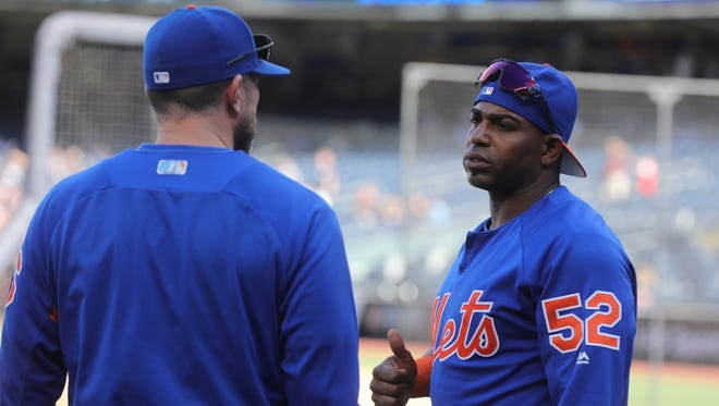 Mets manager Mickey Calloway, left, talks with Yoenis Cespedes during batting practice on Friday, July 20, 2018 as the Mets get ready to play the Yankees at Yankee Stadium. Cespedes is the DH in his first game back with the Mets since going on the disabled list on May 13.