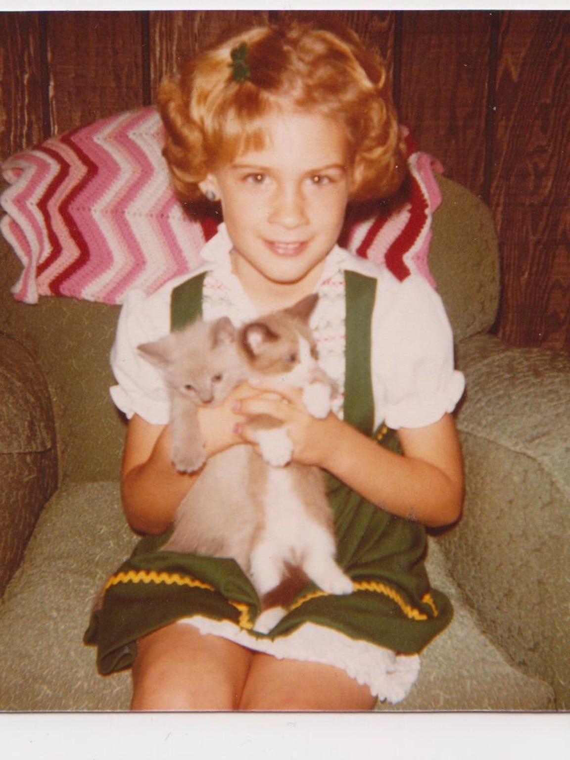 Heidi Wolfe poses for a picture with two kittens. Year unknown.