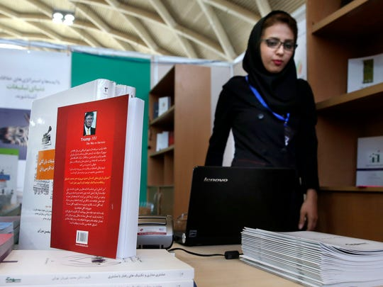 "This picture taken on Tuesday, May 10, 2016 shows, U.S. presidential candidate Donald Trump's book "" Trump 101: The Way To Success"" translated to Persian on display during Tehran's International Book Fair in Iran. After decades of officially-imposed detachment from the ""Great Satan,"" Iranians are this time transfixed by the wild U.S. presidential campaign, mindful that the next White House occupant could have direct impact on their lives. Although there are no polls about Iranians' views on the U.S. presidential campaign, there is a sense of apprehension regarding Trump, even though some consider his criticism mostly bluster."