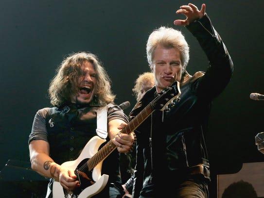 Phil X (left) and Jon Bon Jovi perform at FedExFourm