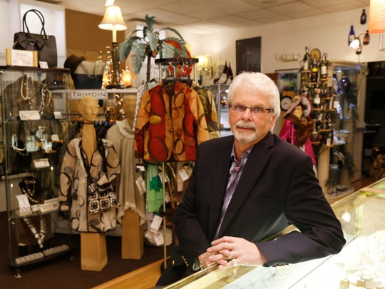 Bruce Potter, owner of Courtyard Gifts on Washington Street in Binghamton on Wednesday.  Potter, who has owned the store for 23 years plans, to move his store to Owego starting in August.
