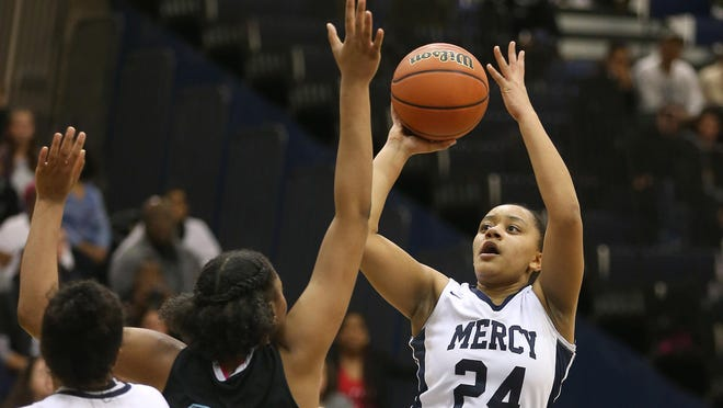 Mercy's Traiva Breedlove shoots over Bishop Kearney's Sanaa Wilson (21) in route to winning the A1 championship.
