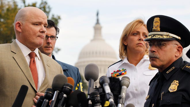 Secret Service spokesman Ed Donovan, Left, Washington Police Chief Cathy Lanier, second from right, and U.S. Capitol Police Chief Kim Dine, right, address the media regarding a police chase and shooting, on Capitol Hill in Washington, Thursday, Oct. 3, 2013.