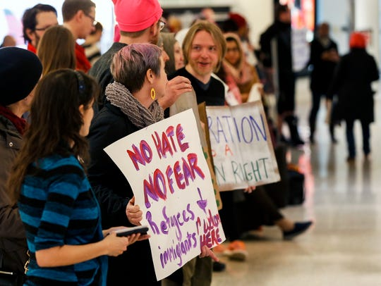 People gathered at the Louisville International Airport