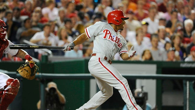 Philadelphia Phillies center fielder Ben Revere hits an RBI double against the Washington Nationals during the sixth inning Friday at Nationals Park. Credit: Brad Mills-USA TODAY Sports