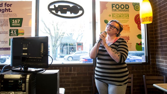 Amanda Alexander sings 'Uninvited' by Alanis Morissette during a weekly karaoke event held at the Subway restaurant on Carlisle Street in Hanover.
