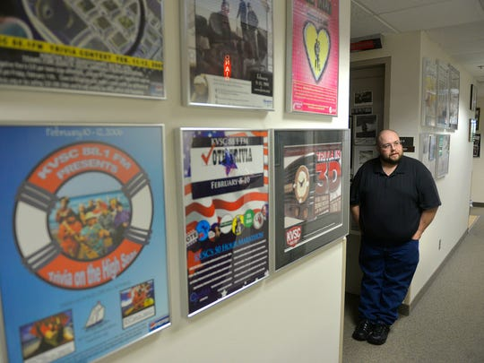 Posters from past annual trivia weekends adorn the walls of a hallway at KVSC as Director of Operations Jim Gray talks about the station's 48-year history.
