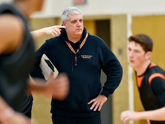 Tom Triggs watches his York Suburban basketball team practice in 2016.
