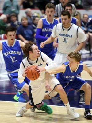 Moravia's Joey Peppe (5) looks for an open teammate against Haldane during the boys Class C semifinal at the Glens Falls Civic Center March 11, 2016. Haldane won the game 36-34.