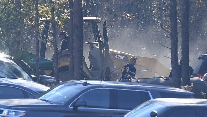 An excavator is active in the Todd Kohlhepp property.