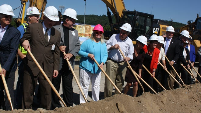 Local officials join the executives of Tioga Downs in breaking the ground of its new hotel.