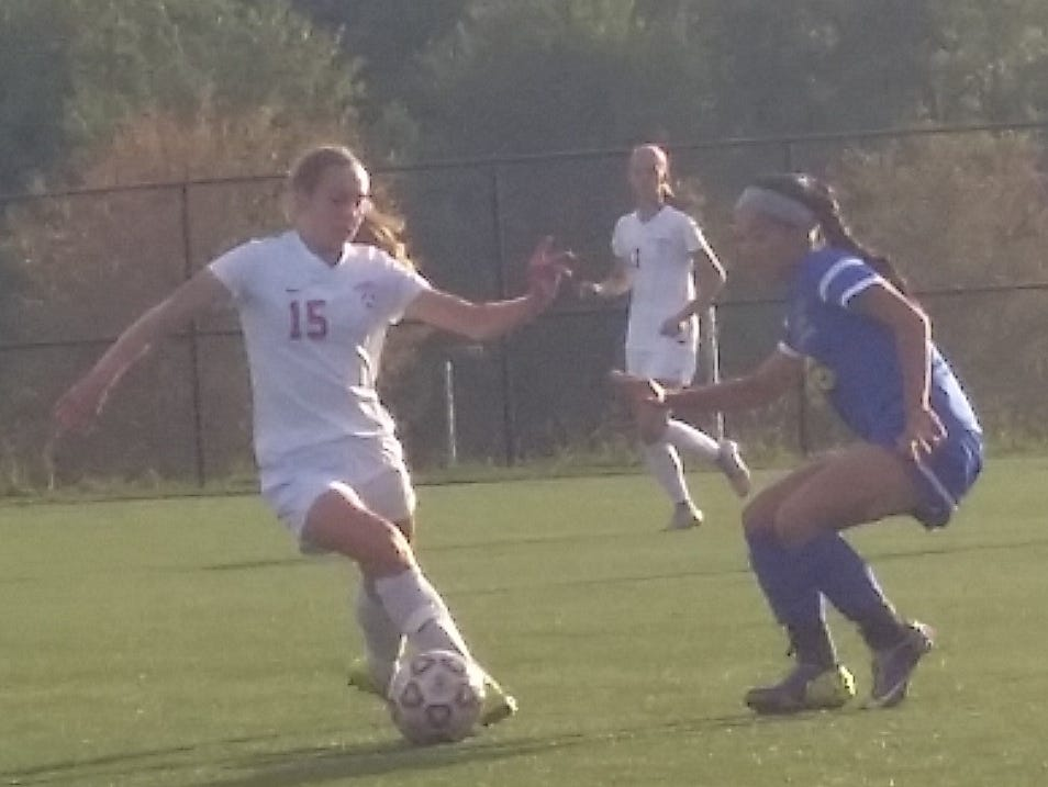 Somers junior defender Mary Murphy attempts to dribble past Mahopac junior forward Kayleigh Miller during the second half of a game at Somers High School on Friday, September 25th, 2015. Somers won 7-0.