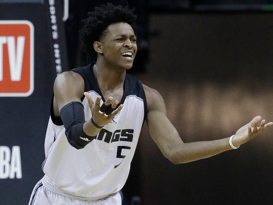 Sacramento Kings' De'Aaron Fox reacts after a play against the Phoenix Suns during the first half of an NBA summer league basketball game, Friday, July 7, 2017, in Las Vegas. (AP Photo/John Locher)