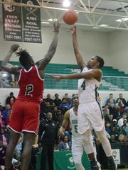Peabody's Kyron Gibson (4) shoots a floater against Richwood Friday, March 2, 2018 at the Emerald Palace.
