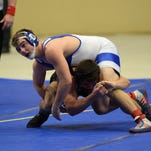 Alex McIntosh of Oldham County (top) wrestles Brandon Devins of Boyle County in the 170 lb. weight class during the KHSAA State Wrestling Championships Wednesday, March 11, 2015.