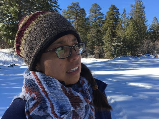 Robyn Jackson, a member of Diné CARE, talks about the purpose of a tour to oil and gas sites located on Ch'ooshgai Mountain on Jan. 11.