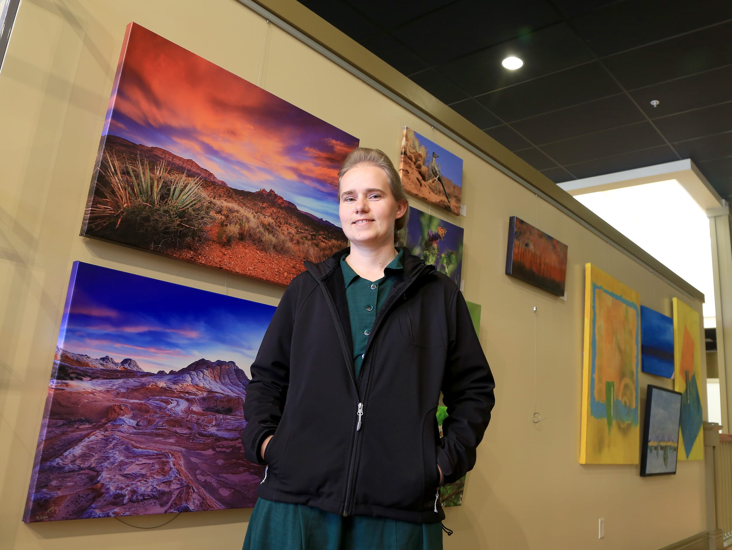 Maria Jeffs, a photographer from Hildale, stands in