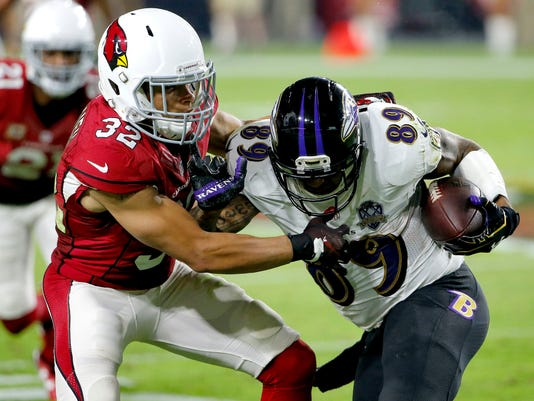 FILE - In this Oct. 26, 2015, file photo, Baltimore Ravens wide receiver Steve Smith (89) is stopped by Arizona Cardinals free safety Tyrann Mathieu (32) during the second half of an NFL football game in Glendale, Ariz. This is a team that knows it's good as long as Carson Palmer stays healthy and Tyrann Mathieu returns strong from a torn ACL.  (AP Photo/Ross D. Franklin, File)
