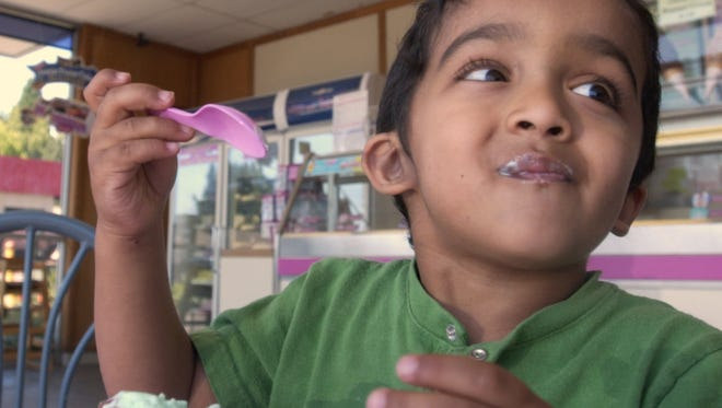 Nikhil Namburi, 3, picked his Pistachio Almond ice cream for its color, green, while celebrating his brother's birthday at the Baskin Robbins 31 Ice Cream Store on River Road in Keizer Friday, August 5, 2005. (Lori Cain /Statesman Journal)