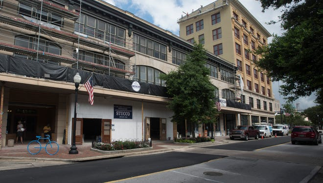 Workers continue renovating the Brent and Blount Buildings in downtown Pensacola on Wednesday, June 14, 2017. The historic building is located at the corner of Palafox and Garden streets.