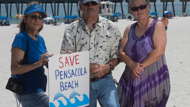 Local activists, Dianne Krumel, left, Barry Goodson, right, and Pat Cook, right, oppose the passage of U.S. Rep. Matt Gaetz bill to allow for private ownership of Pensacola Beach and Navarre Beach land by private citizens. The activists worry the proposed legislation will limit citizen access.