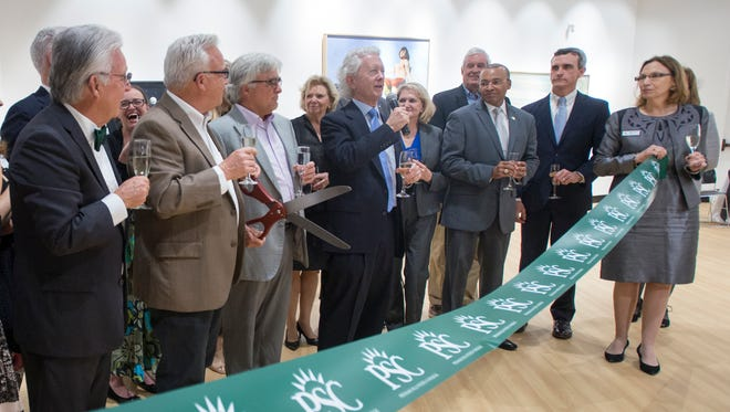 Charlie Lamar gives a toast during the dedication of the Chalres W. Lamar Studio at Pensacola State College in Pensacola on Tuesday, February 20, 2018.