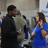 A line builds as job seekers wait to talk to Crest Industries representatives  Wednesday afternoon during a career fair hosted by Central Louisiana Society for Human Resource Management.