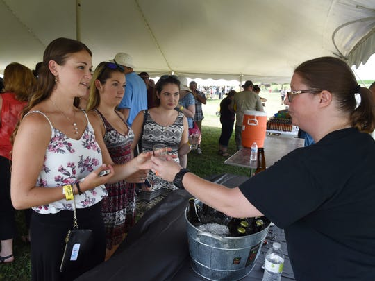 From left, Lexi Breheny of Nyack, Lena Cheyne and Amanda Lawrence of Washingtonville try Pitchfork Hard Cider from Erin Dyke during the Hudson Valley Cider Festival at Barton Orchards in Poughquag in 2016.